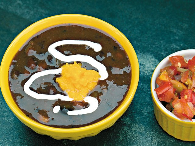 Spicy black bean soup with sweet potato puree