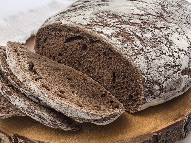 Pumpernickel Bread Loaf with Slices, Vert