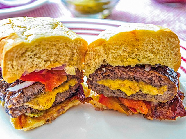 Stuffed Cheeseburger Cut Open Close Up Horiz