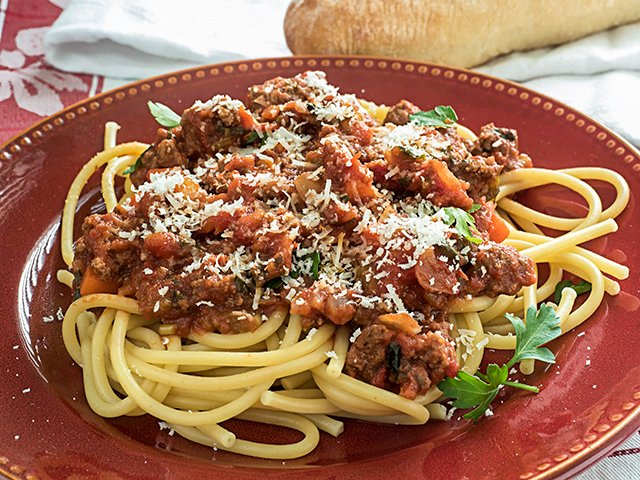 Pasta with Meat Sauce Closeup with Bread Loaf