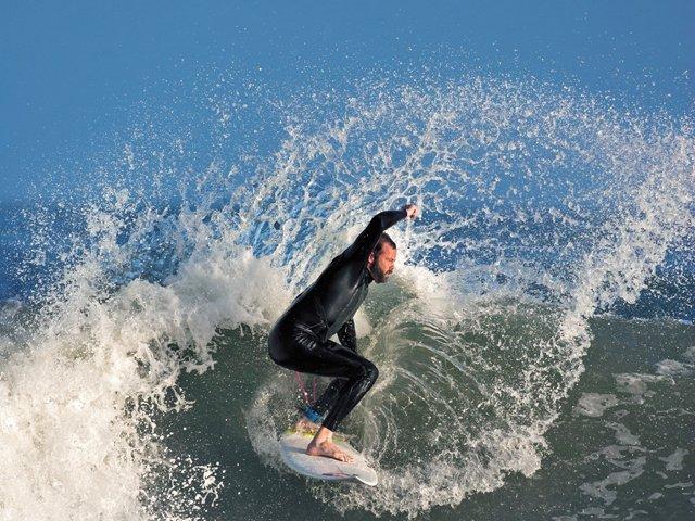 Travels_SurfsUp_Surfing.jpg
