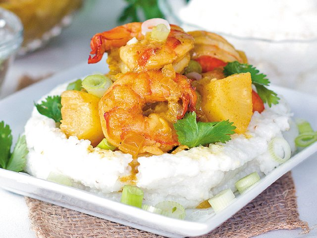 Coconut shrimp and grits with pineapple curry sauce